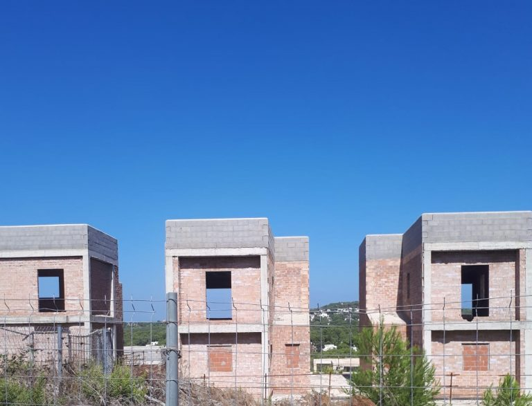Complex of 32 houses under construction for sale Cala Tarida